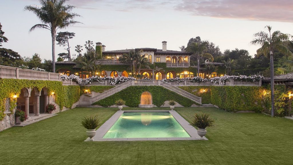 mediterranean masterpiece home accented with moroccan style arches